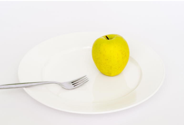 Clean eating is the new under cover eating disorder: Clean Eating: The New Under Cover Eating Disorder: yellow apple and fork: www.nmefitnesstraining.com
