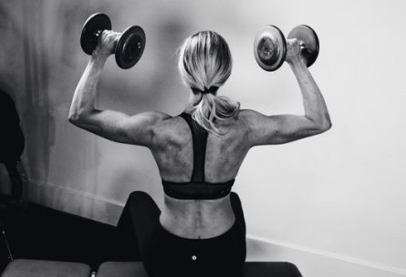 How often to lift weights per week: www.nmefitnesstraining.com: Laura M. Howell Shoulder Press Seated Black and White Shot: Just Lift: How Often You Should be Lifting Weights Per Week: No More Excuses Fitness Training