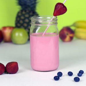 The Big Shake-up: The Best Time To Drink a Protein Shake: 1 pink protein shakes in Mason Jars with 1 strawberry: No More Excuses Fitness training: www.nmefitnesstraining.com